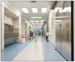 Doctor walking down a ward of a hospital